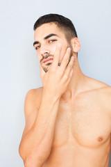 handsome man touching his beard