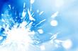 Sparkler with defocused lights in blue