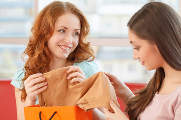 image of two teenage girls looking at clothes.