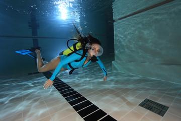 Female scuba diver underwater in the pool