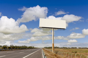 Blank billboard by the highwa