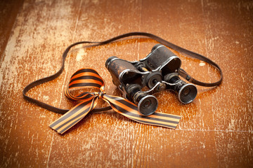 May 9. Vintage military binoculars and George Ribbon