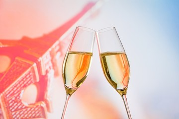 champagne flutes with golden bubbles on blur background