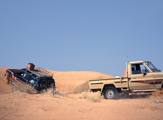 Broken down vehicle in the sand of the desert