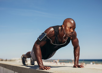 Young athletic man doing push-ups