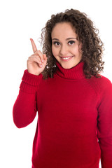 Junges Frau in Rot mit Zeigefinger zum Text isoliert