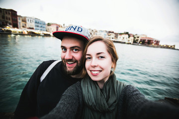 Beautiful couple of tourists take travel selfie while honeymoon