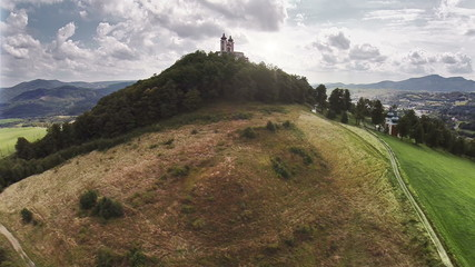 Castle on the Hill in sunset - aerial footage