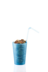 coins in cup with straw