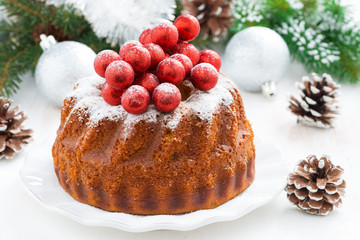Christmas cake on a plate and decorations