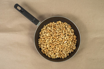 Roasted cashews in frying pan