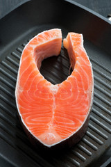 fresh salmon steak on the grill pan, vertical