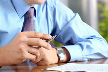 businessman  doing business, sitting at his desk in the office,