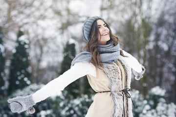 Young woman enjoying fresh nature in winter time