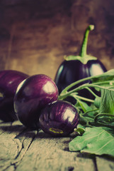 Eggplants on the wooden background
