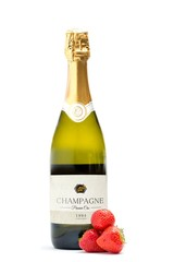 Bottle of champagne with three strawberries