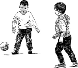 little boys playing with a ball