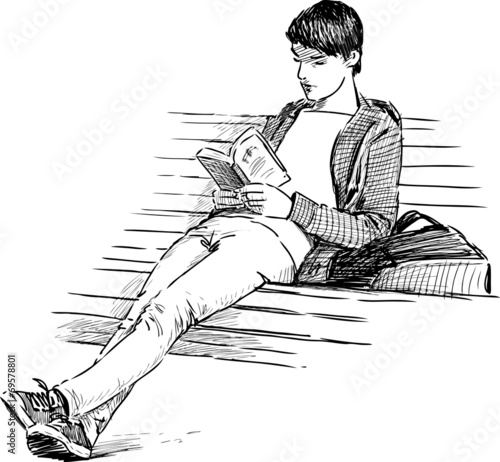 young man reading - 69578801