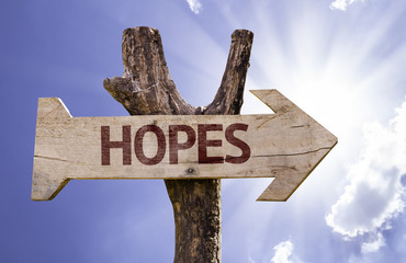 Hopes wooden sign with a beautiful day background