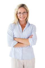Happy blonde wearing reading glasses