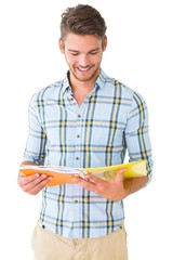 Handsome student reading from notepad