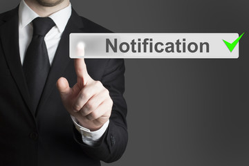 businessman pushing button notification