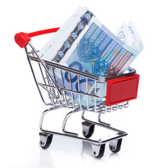Banknotes in small shopping trolley