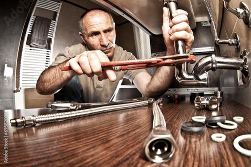 plumber at work - 69582005