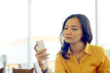 Young Pretty Attractive Asian Woman Texting Her Smartphone