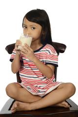 Cute Little Asian Girl Drinking Milk