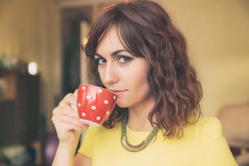 Woman Drinking from Red Polka Dot Tea Mug