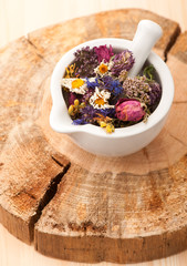 Dried herbs and flowers in mortar