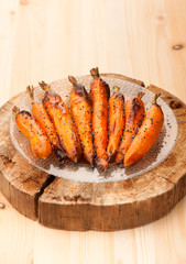 Roasted carrots on wooden board