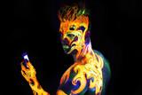 Body art glowing in ultraviolet light poster