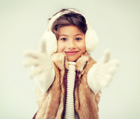 happy littl girl in winter clothes