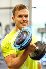 smiling man with dumbbell in gym