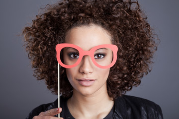 young mixed-race woman with fake paper glasses