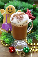 Glass of hot chocolate and Christmas gingerbread man