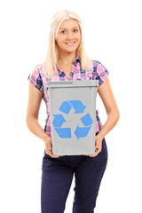 Blond woman holding a recycle bin