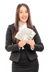 Delighted businesswoman holding a stack of money