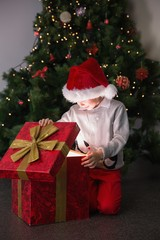 Child opening his christmas present