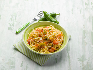 spaghetti with green hot chili pepper and fresh tomatoes