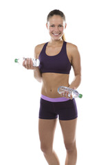 Smiling fit athletic woman with bottled water