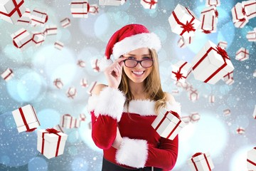 Composite image of sexy santa girl wearing spectacles