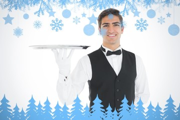 Composite image of attractive waiter presenting an empty tray