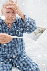 Composite image of old man taking his temperature