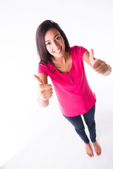 cheerful young woman thumbs up with positive winning attitude