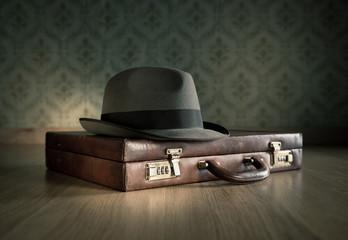 Borsalino hat and briefcase
