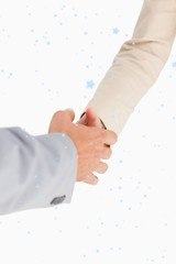 Composite image of people shaking hands