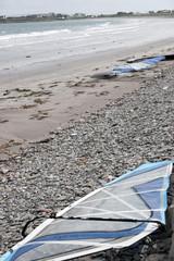 windsurfers surfboards on the beach